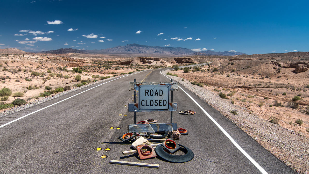 ROAD CLOSED // Blue Closed Clouds And Sky Country Road Desert Diminishing Perspective Empty EyeEm Best Shots Landscape No People Outdoors Road Road Road Closed Road Marking Road Sign Roadscapes Roadtrip Sign Sky The Way Forward Vanishing Point