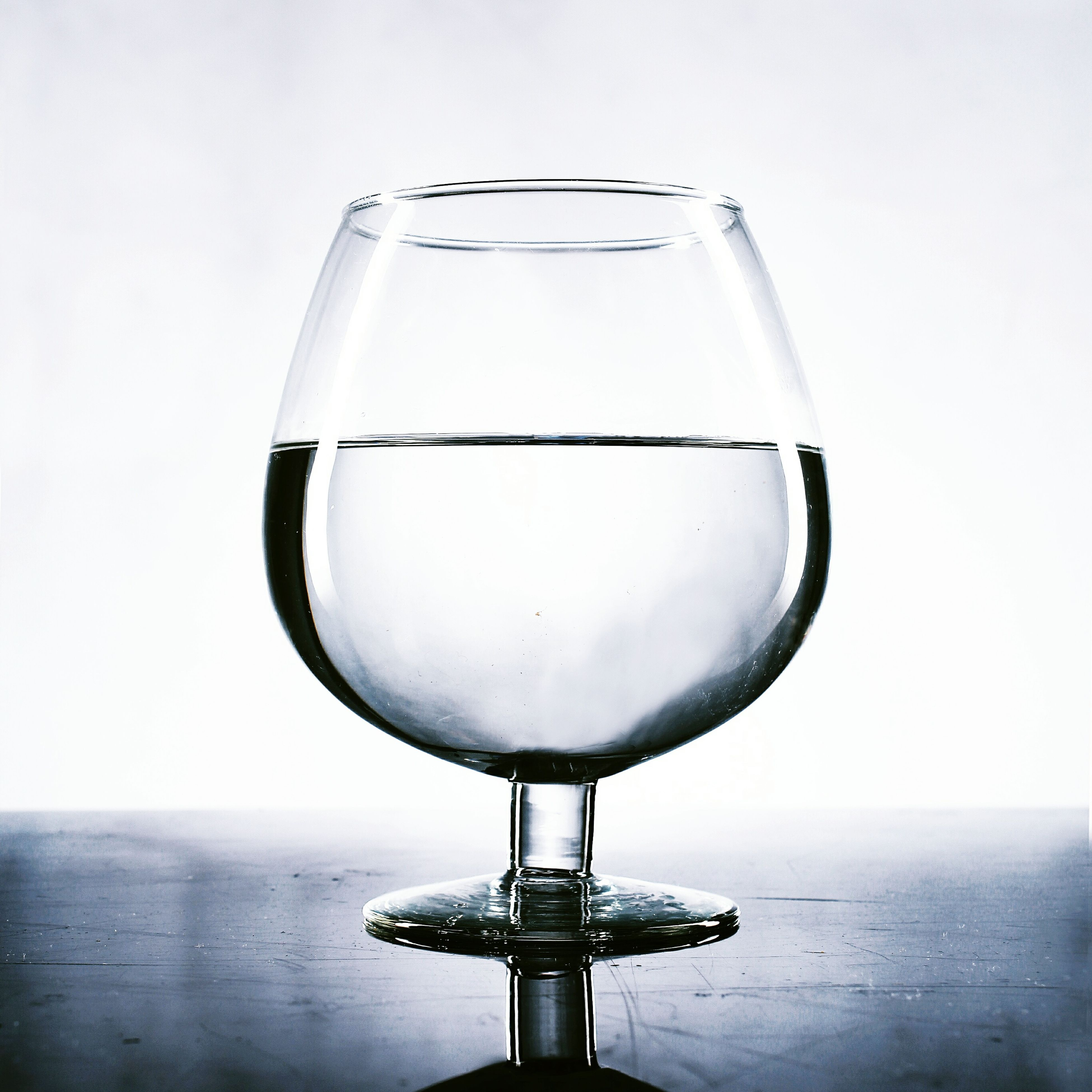 transparent, glass - material, close-up, water, refreshment, drinking glass, wineglass, drink, reflection, food and drink, focus on foreground, wine, indoors, single object, drop, glass, alcohol, sky, copy space, clear sky