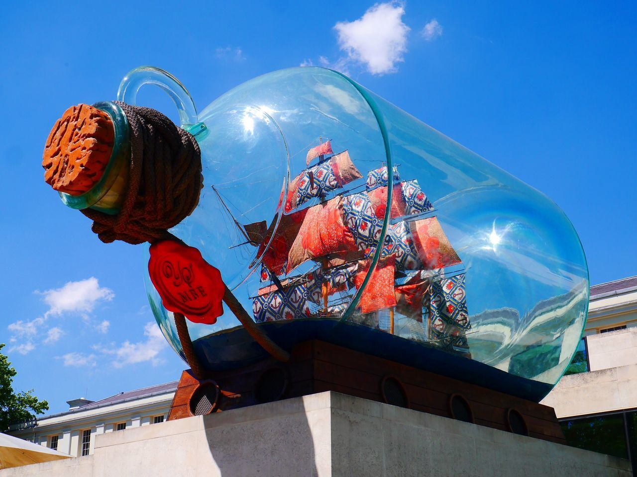 A message in a bottle Sky Cloud - Sky Low Angle View Outdoors Architecture Blue No People Day Built Structure Fish-eye Lens City Message In A Bottle Ship In A Bottle Art Is Everywhere Art Fund The Great Outdoors - 2017 EyeEm Awards
