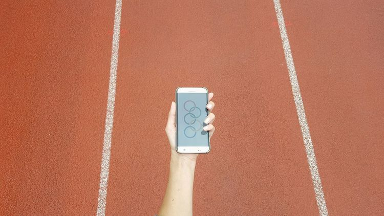 Relay runner Running Track Sport Competition Sports Track Close-up Competitive Sport Outdoors Mobile Conversations In Shape Fitness Orange Background Dusgiganten Healthy Lifestyle Relay Runners Samsung Mobilephone Female Hand Running Human Hand Directly Above Human Body Part Olympics