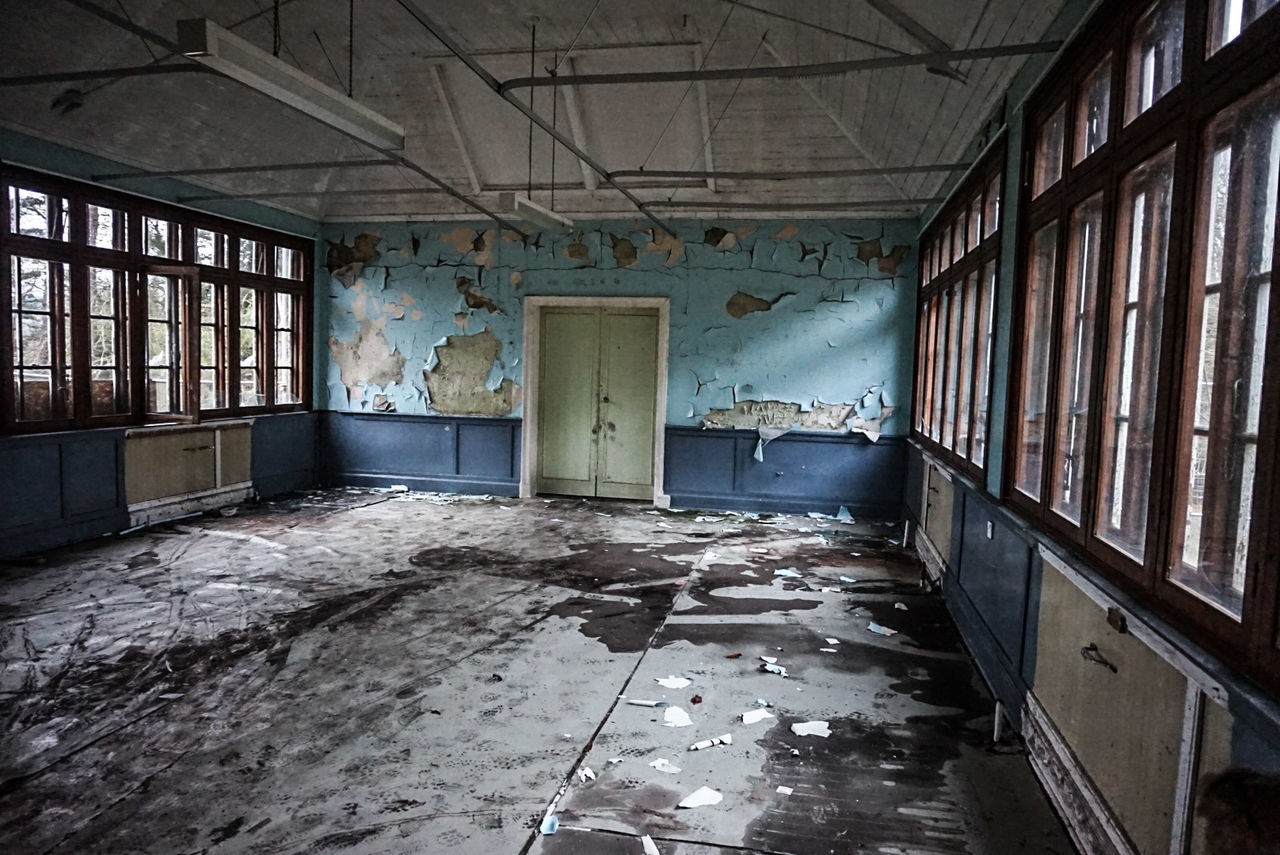 Abandoned Interior With Peeled Walls And Windows
