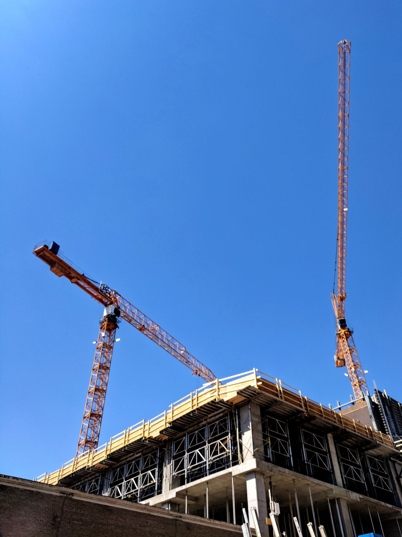 Built Structure Architecture Low Angle View No People Day Outdoors Clear Sky Sky City Construction Crane Construction Machinery Construction Site Construction Building Exterior Clear Sky Low Angle View Blue Architecture Google Pixel XL