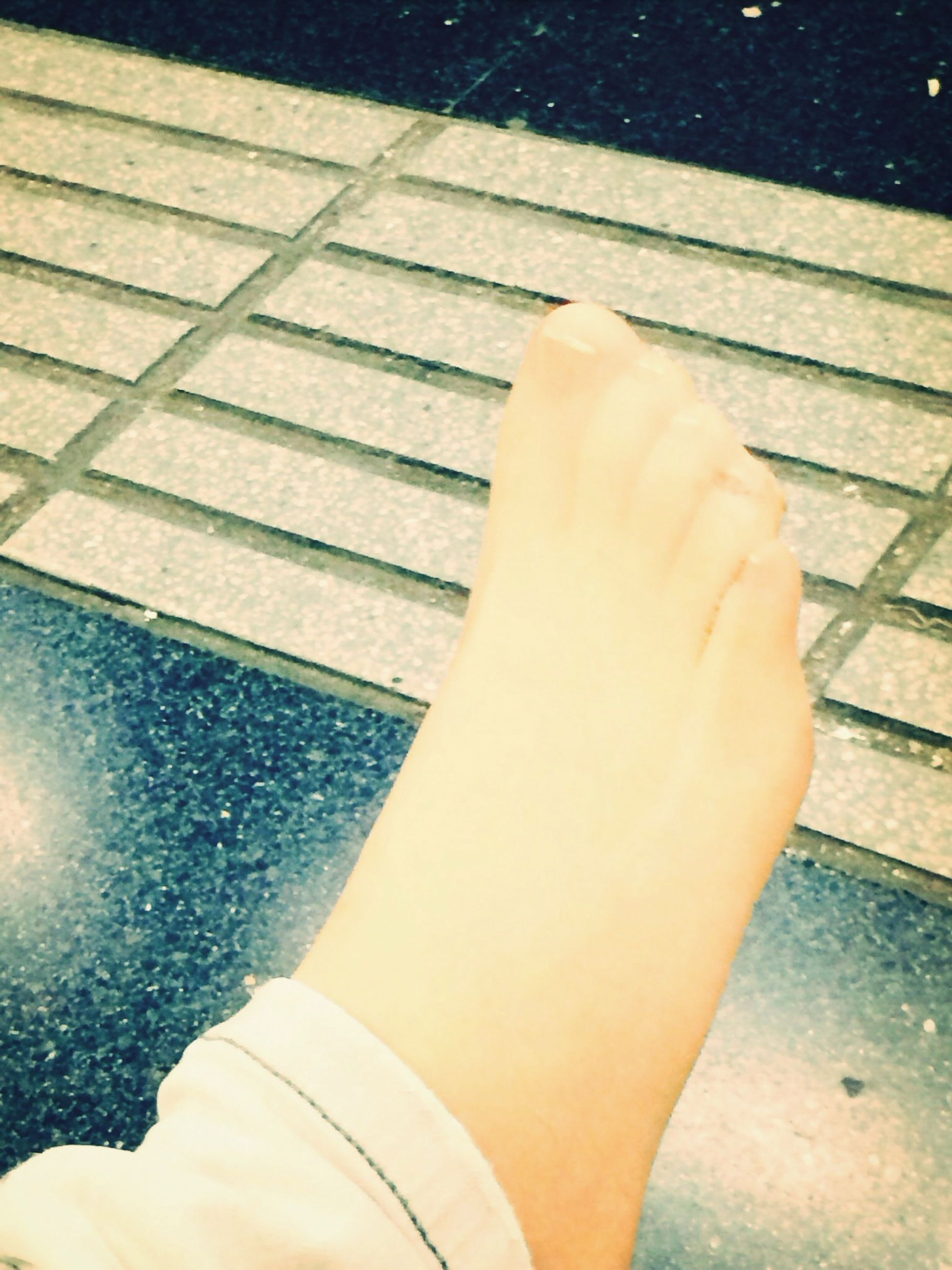high angle view, low section, personal perspective, person, lifestyles, part of, unrecognizable person, leisure activity, men, sunlight, shadow, cropped, human foot, standing, directly above