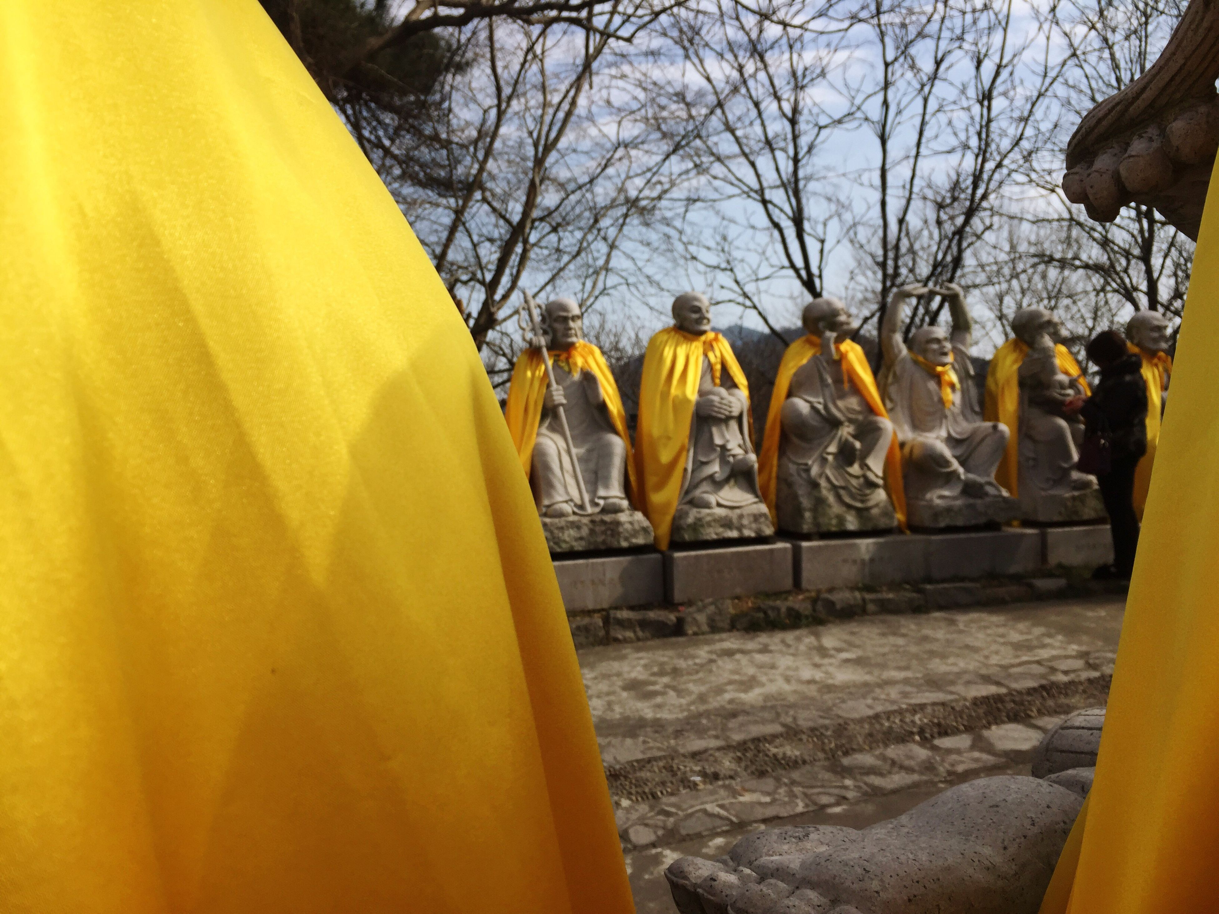 yellow, religion, spirituality, built structure, place of worship, tree, no people, outdoors, day, statue, architecture