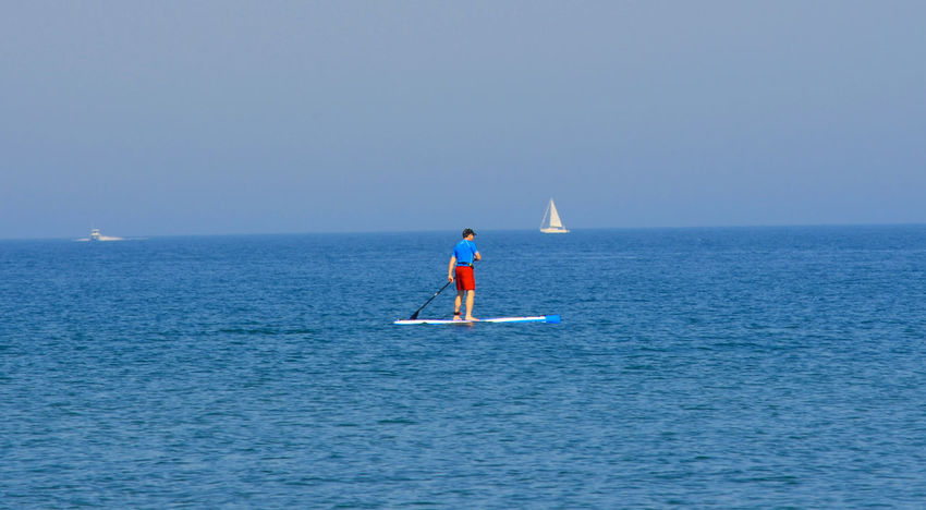 Adult Adventure Athlete Beauty In Nature Blue Clear Sky Day Full Length Healthy Lifestyle Horizon Over Water Leisure Activity Nature Oar One Person Outdoors Paddleboarding People Scenics Sea Sky Sport Vacations Water EyeEmNewHere EyeEmNewHere Be. Ready.