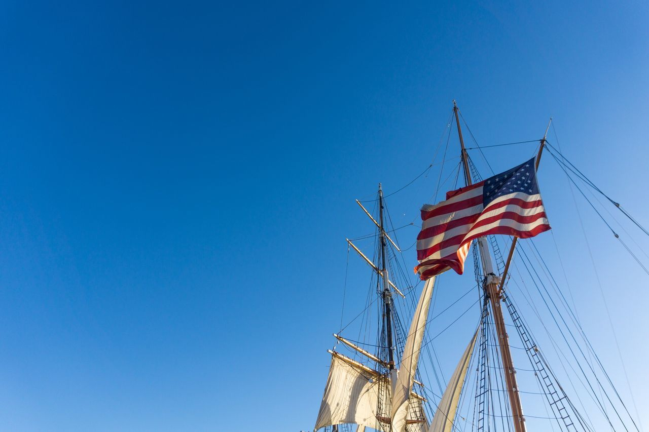Flag Low Angle View Blue Patriotism Clear Sky Day Outdoors No People Sky Architecture California Dreaming San Diego California Love On The Road USA USAtrip Travel Destinations Flags Bay Boat Ship Lifestyles Sea Transportation