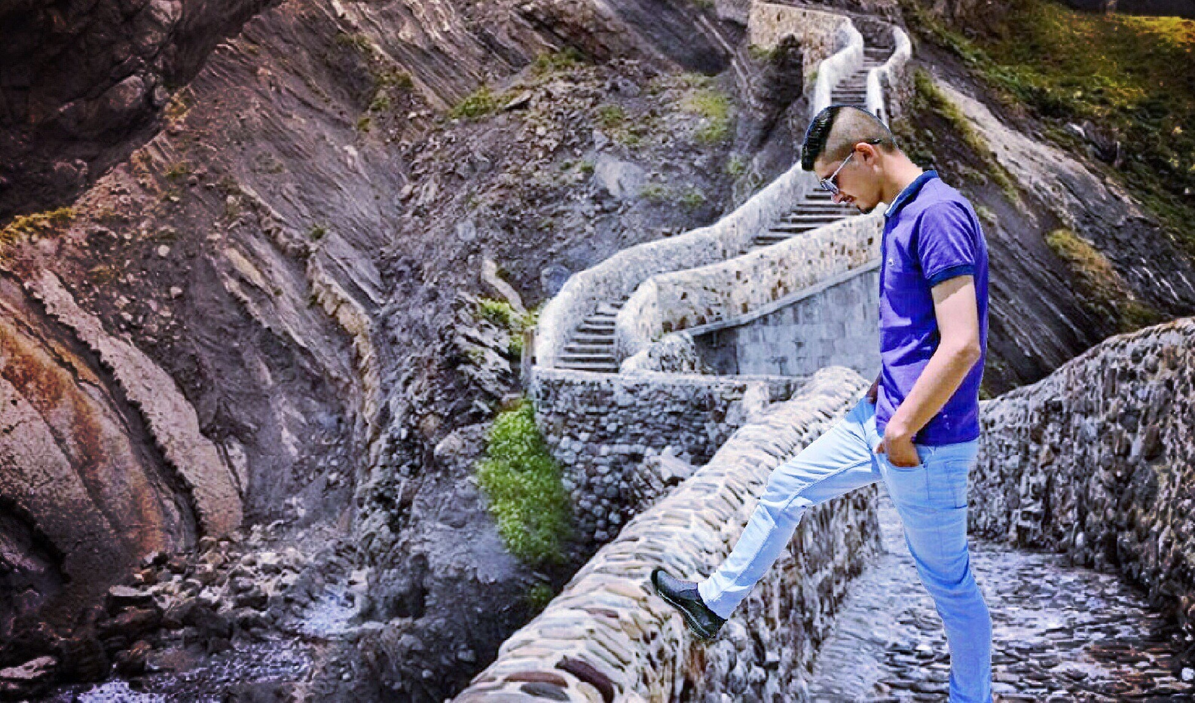 waterfall, rock - object, one person, adventure, mountain, full length, rock climbing, risk, climbing, one woman only, beautiful woman, activity, outdoors, cliff, beauty, beautiful people, day, young adult, people, nature, clambering, adults only, beauty in nature, adult, extreme sports, water, young women, only women