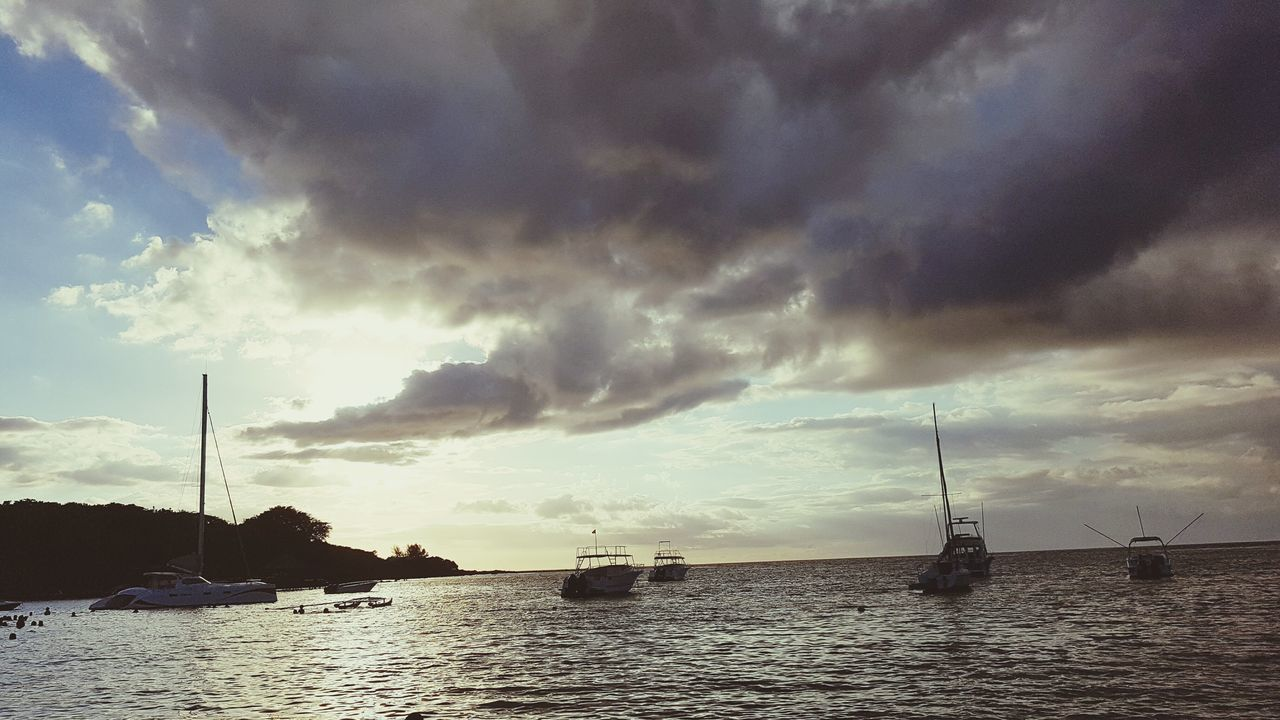 Cloud - Sky Dramatic Sky Reflection Outdoors Tranquility Nautical Vessel Sea Shiplife Travel Destinations Beauty In Nature Coastline Vacations Dramatic Sky Environmental Conservation Beach
