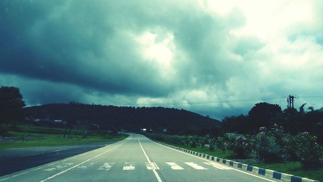 The Way Forward Road Countryside Vanishing Point Dramatic Sky Diminishing Perspective Long Sky Storm Cloud Tranquil Scene Scenics Cloud - Sky Solitude Cloudy Overcast Road Marking Transportation Landscape Cloud Tranquility Paths Way First Eyeem Photo