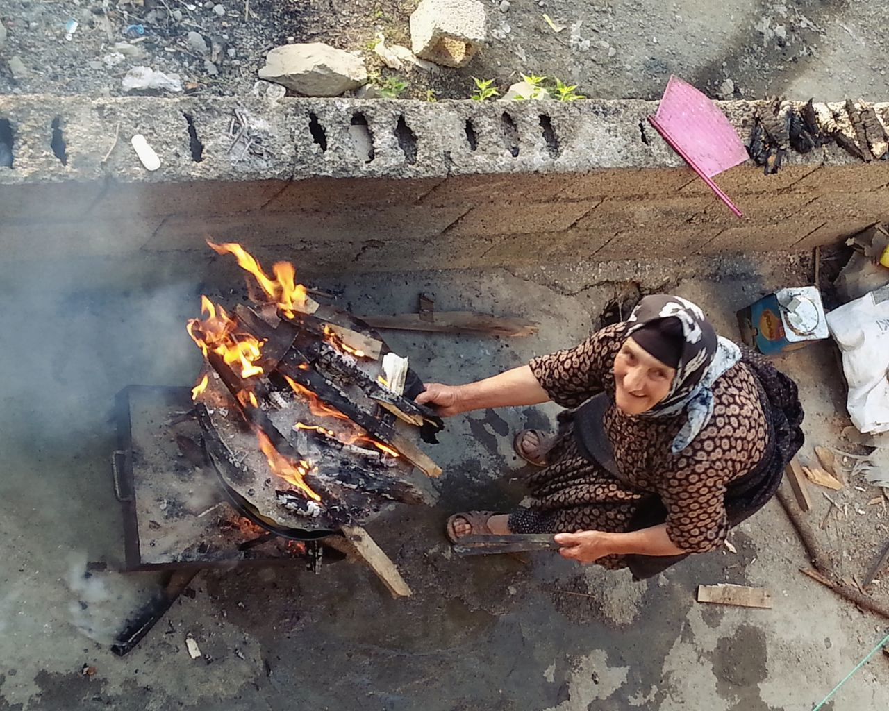 One Person Burning Cooking Outdoors Food Day Tranquility Handmade Outdoors Woman Portrait Woman Woman Around The World Woman At Work Woman Working Ordinary Day Routine Life Country People Rural Scene Rural Life Rural Making Food Food On Fire Fire Women Around The World
