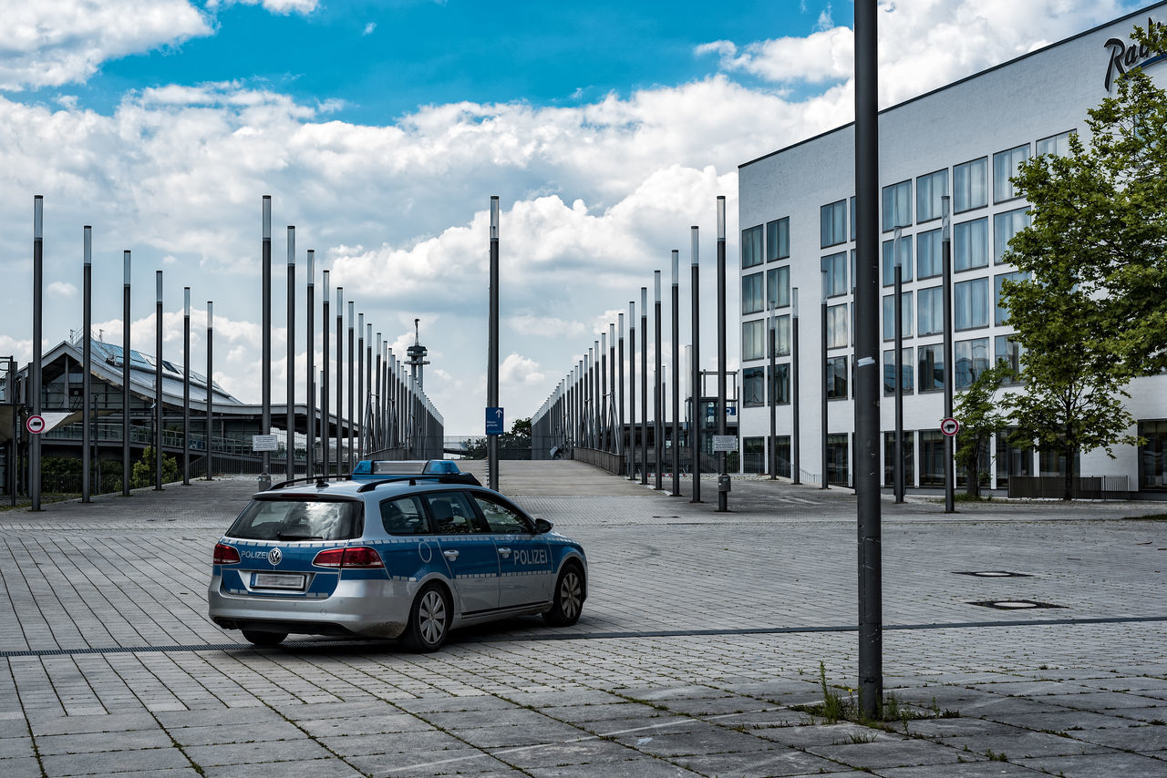 SkyBlue Architecture Blue Building Building Exterior Built Structure City City Life City Street Cloud Cloud - Sky Cloudy Day Expo Areal Hannover Lanterns Mode Of Transport Modern No People Outdoors Parked Parking Sky Stationary Sunny