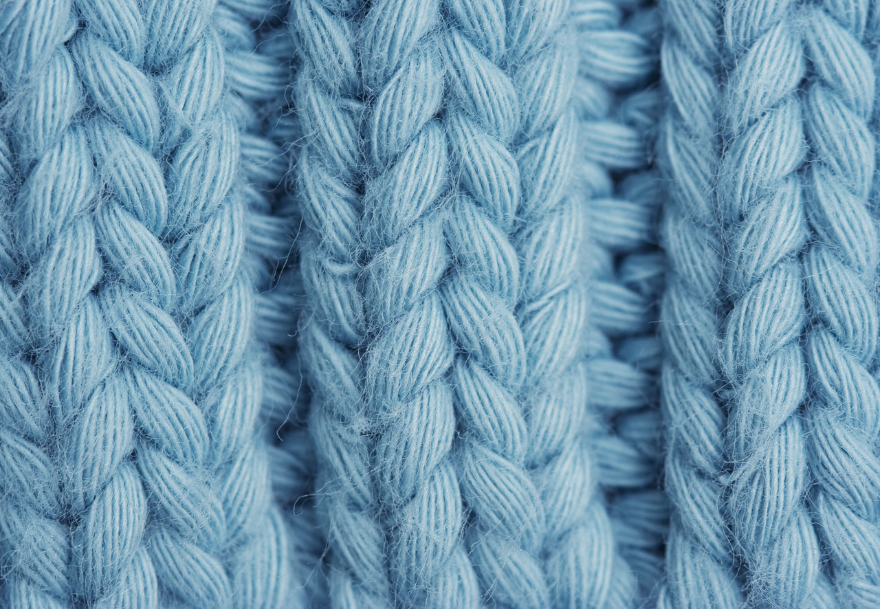 Macro of a woolen Pattern - Knitting Pattern with Purls and Knits Background Backgrounds Blue Close-up Fashion Full Frame Handmade Knit Knitted  Knitting Knitwear Loop Material Natural Natural Pattern Pattern Texture Textured  Textured  Textures And Surfaces Turquoise Warm Warm Clothing Wool Woolen