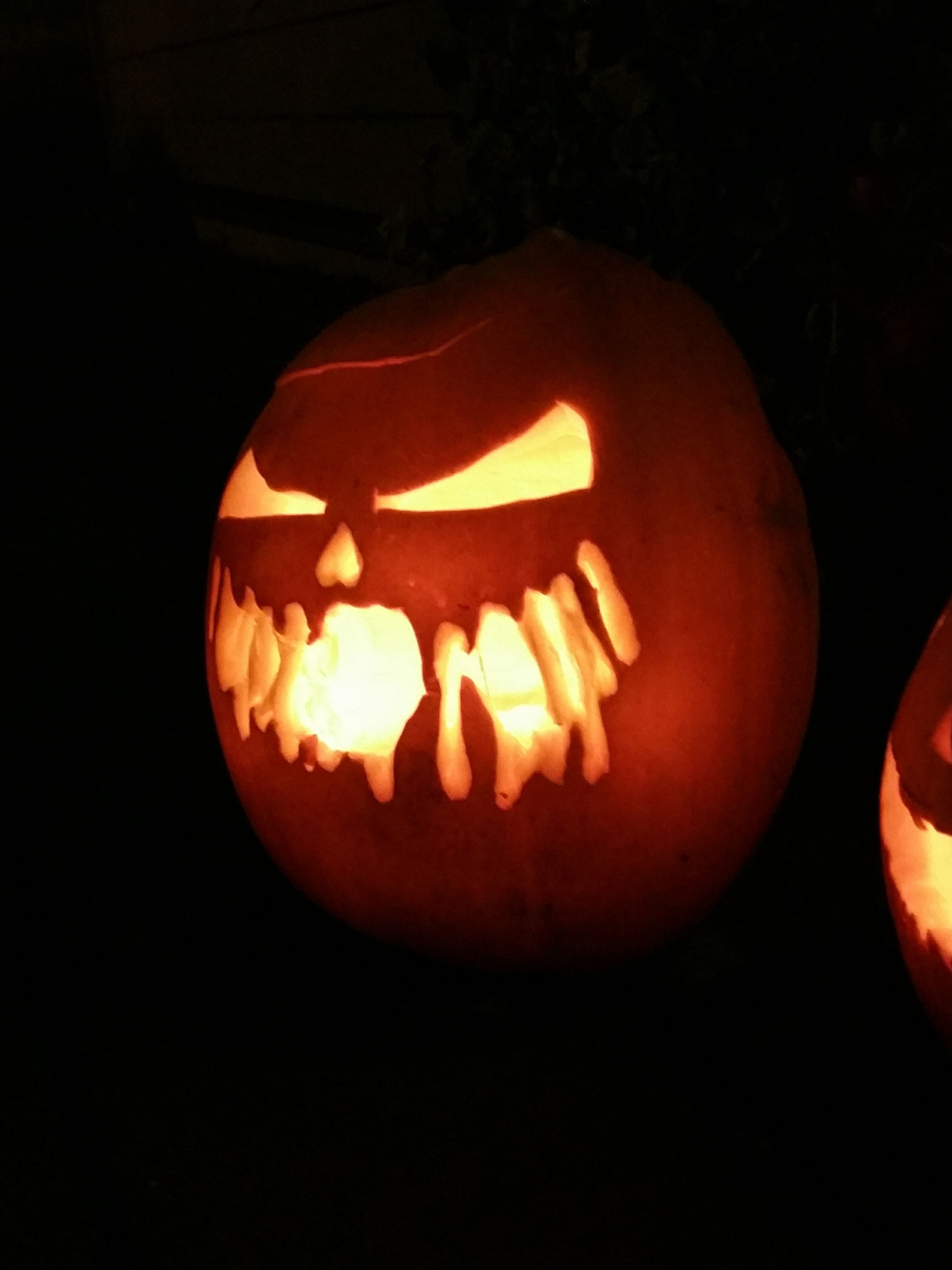 halloween, pumpkin, anthropomorphic face, illuminated, no people, night, black background, close-up, jack o lantern