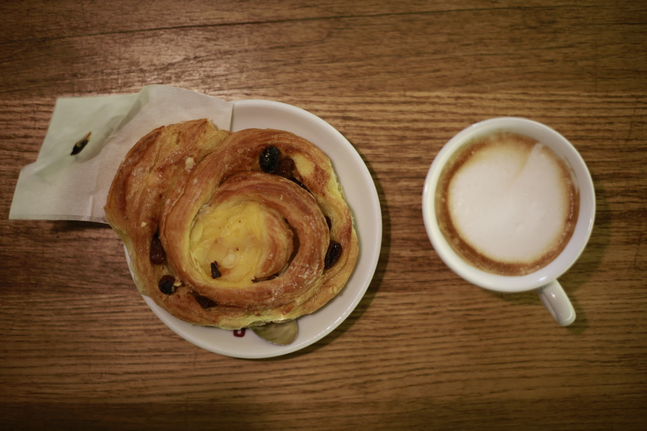 food and drink, table, coffee cup, coffee - drink, refreshment, drink, freshness, frothy drink, still life, indoors, directly above, no people, food, serving size, high angle view, indulgence, plate, cappuccino, close-up, breakfast, ready-to-eat, froth art, healthy eating, sweet food, day