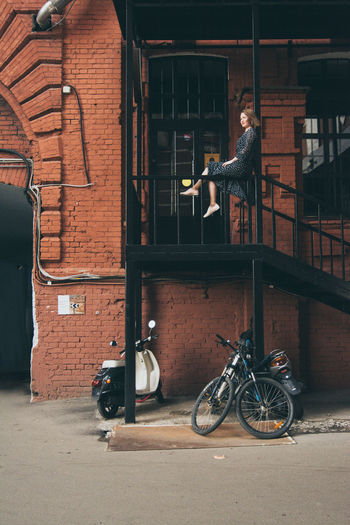 Architecture Bicycle Building Exterior Built Structure Casual Clothing Day Full Length Girl In Dress Inspiration Land Vehicle Mode Of Transport Nice Day Old Bricks Outdoors Red Brick Wall Red October Stairs Standing Transportation Young Adult