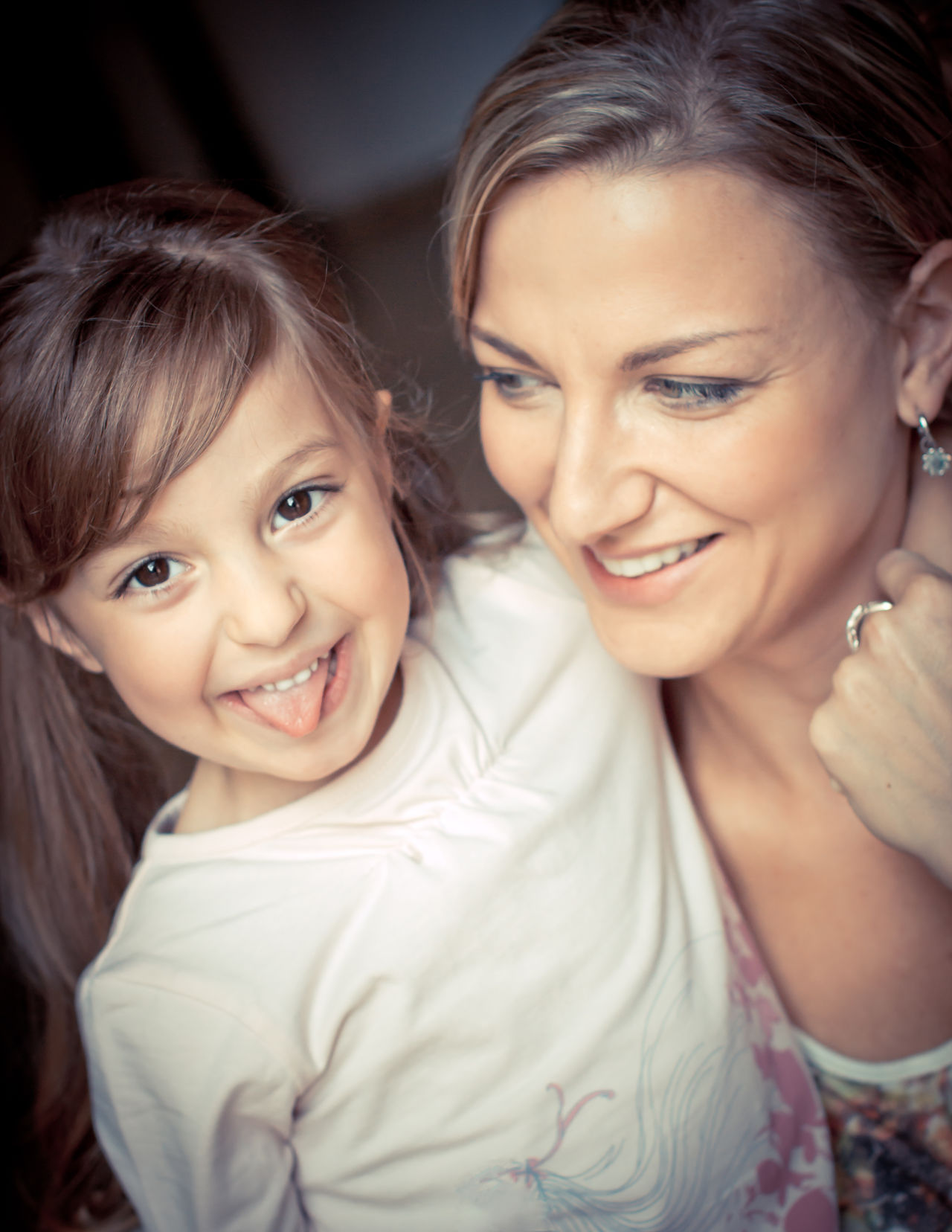 Bonding Cheerful Childhood Close-up Daughter Daughter And Mother Daughters Day Family Girls Happiness Indoors  Looking At Camera Love Mother People Portrait Real People Smiling Togetherness Tounge Out  Two People