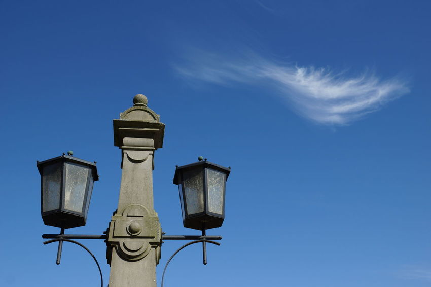Cloud and lantern Blue Bremen Bürgerpark Cirrus Cloud Contrast Day Electric Lamp Electric Light Feather  Fleecy Clouds Lamp Lantern Lightness Low Angle View No People Outdoors Park Pole Sky Stone Street Light Streetlight Sunlight Sunshine