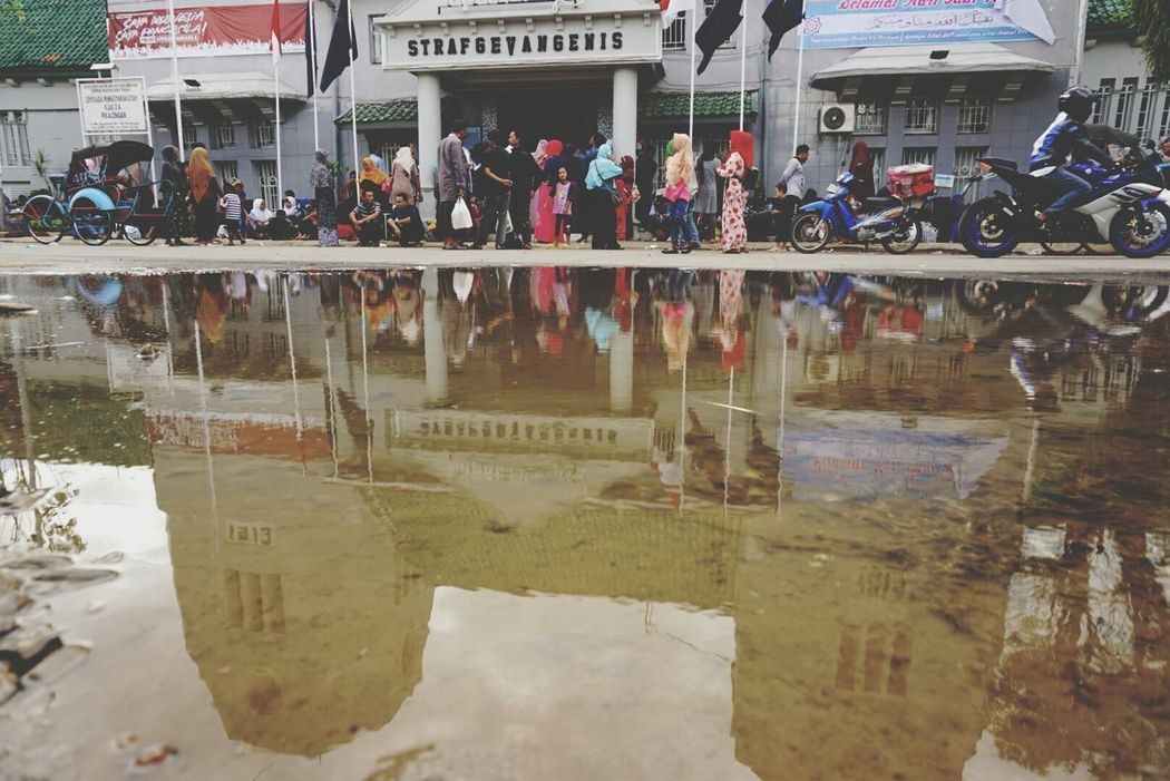 Prison Water Reflection Architecture Flood Building Exterior People Outdoors Adult Day Adults Only Sony A6000 Human Interest INDONESIA Indonesia_allshots Indonesia_photography Ramadhan2017 Idul Fitri Moslem