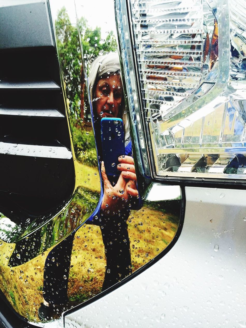 People And Places Rain Stopped Sun On Rain Drops People And Places. Chrome Reflection Truck Grill Maximum Closeness