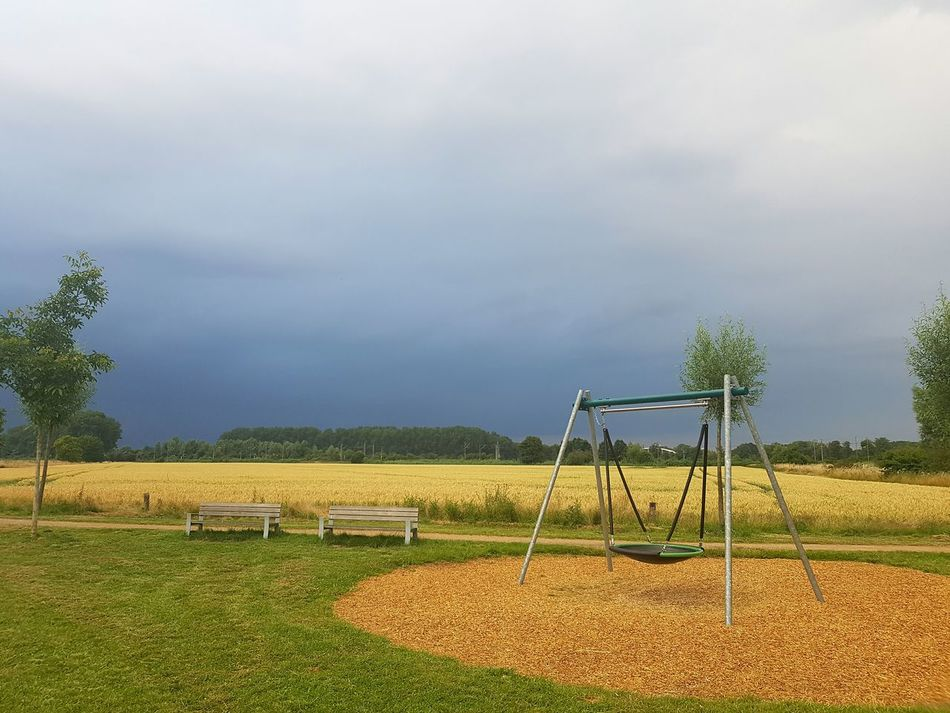 Cloud - Sky Outdoors Day Storm Clouds Playground Sky Field Scenics Landscape Beauty In Nature Nature Cloud Agriculture No People Countryside Remote