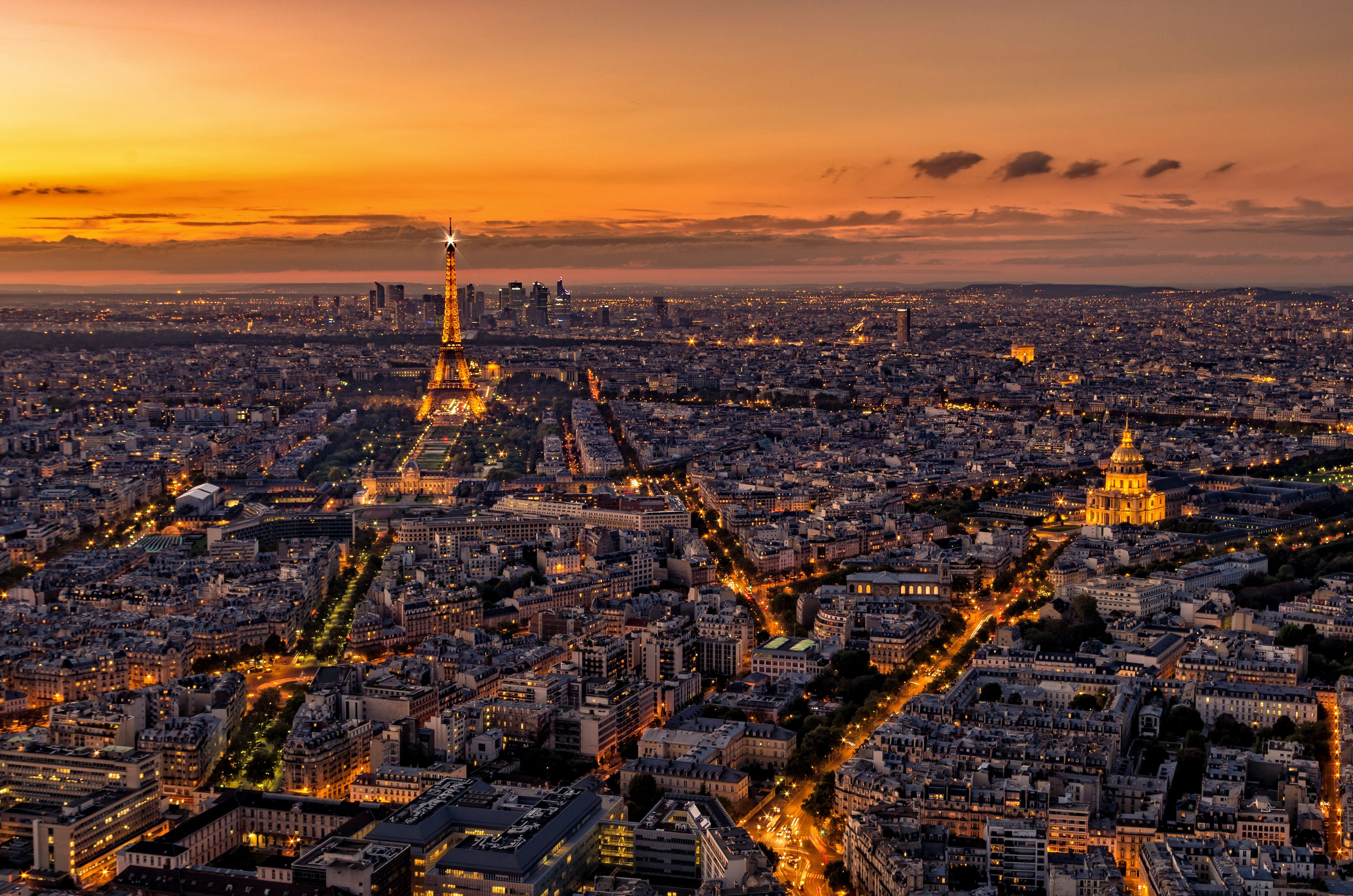 sunset, architecture, built structure, building exterior, sky, cityscape, city, orange color, high angle view, tower, sea, travel destinations, capital cities, water, famous place, dusk, international landmark, tall - high, cloud - sky, outdoors
