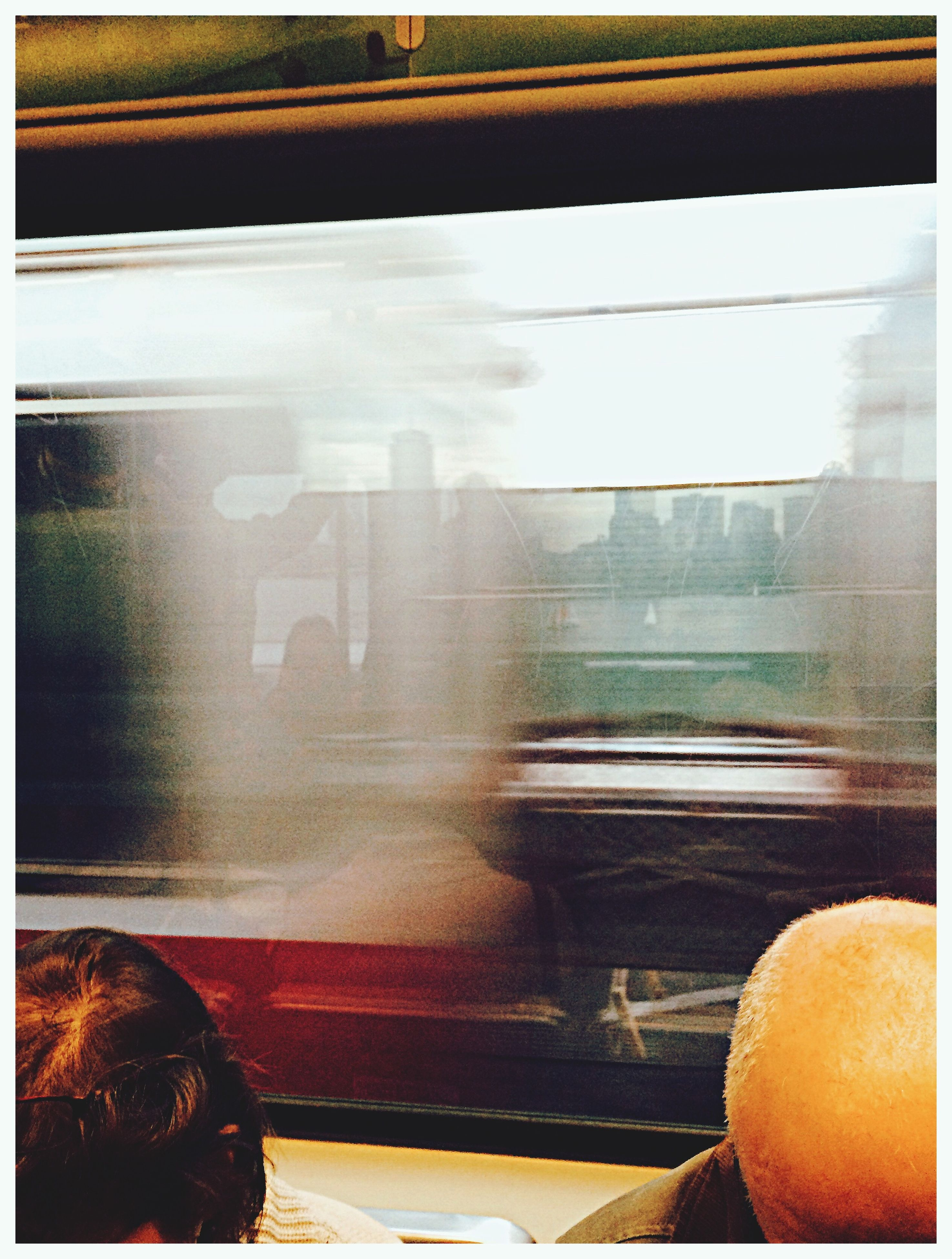 transportation, transfer print, mode of transport, auto post production filter, vehicle interior, glass - material, indoors, land vehicle, transparent, window, travel, public transportation, car, train - vehicle, on the move, blurred motion, car interior, windshield