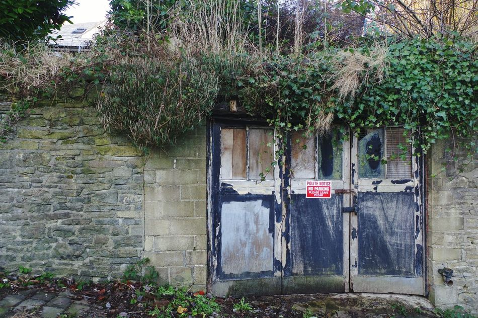Built Structure No People Tree Architecture Text Outdoors Day Nature Light And Shadow Sunlight And Shadow Textures And Surfaces Yorkshire Garage Doors Sign Town Residential Building Double Doors Building Exterior Building Buildings Backgrounds Wall