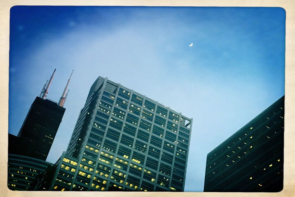 The days, they get longer. Building Exterior City Architecture Built Structure Skyscraper Sky Low Angle View No People Outdoors Travel Destinations Cityscape Modern Day Urban Skyline Downtown District Moon Hipstamatic