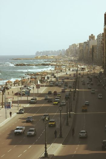 The sea road,Alexandria,Egypt Egypt Alexandria Road Way Cars Street Cityscapes Architecture ArchiTexture Treavelling Alexandria Egypt Streets People Population Cross Street Autos Sea Beach Sea Front