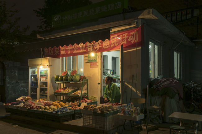 Local grocery in a Beijing China hutong at night. Beijing Beijing By Night Beijing China Beijing Scenes Beijing, China Culture Hutong Hutong Life Illuminated Market Market Stall Store