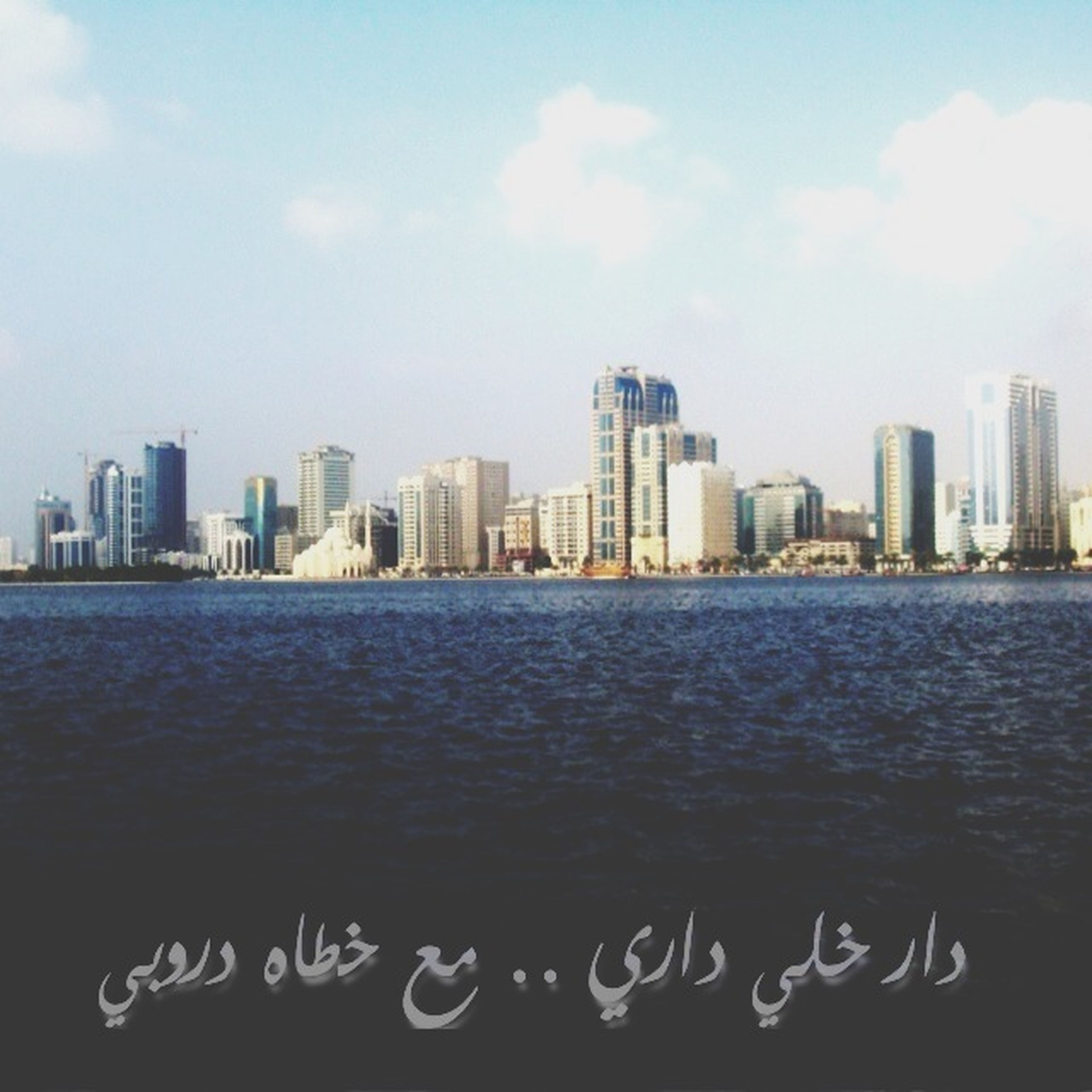 city, building exterior, architecture, skyscraper, water, built structure, sky, cityscape, waterfront, urban skyline, river, sea, office building, modern, tower, skyline, tall - high, cloud - sky, cloud, rippled