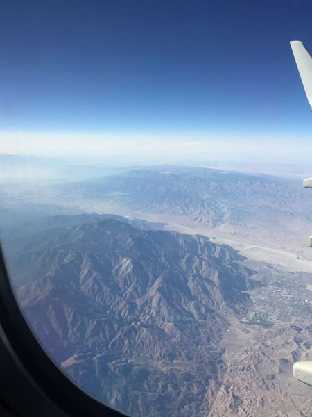 Taking Pictures From An Airplane Window Flying Mountains