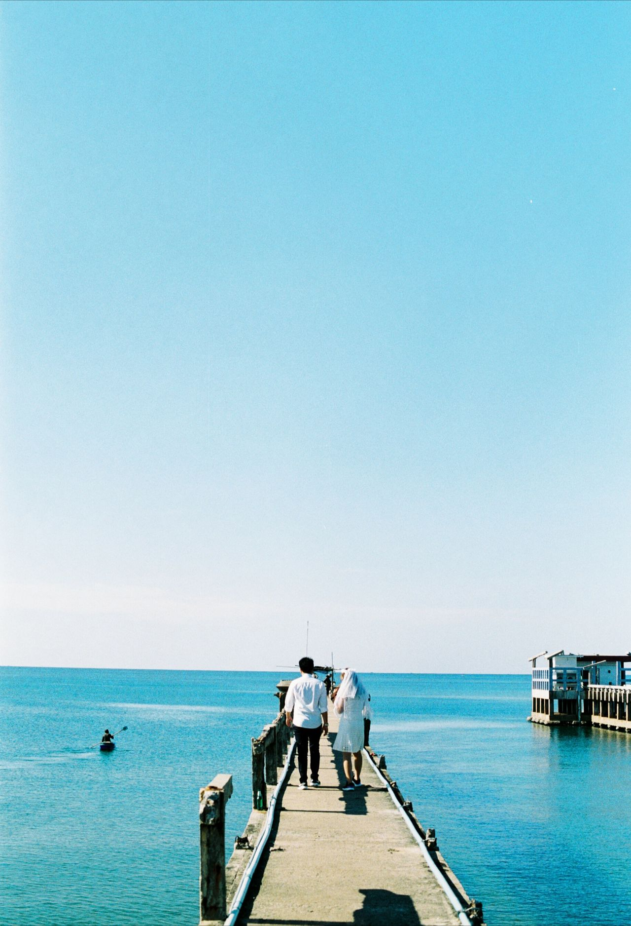 Live For The Story Sea Beach Horizon Over Water Blue Sunny Vacations Sky Adult Clear Sky Outdoors Water Summer People Togetherness Day Nautical Vessel Travel Destinations Full Length Feeling Nofilter Holiday EyeEmNewHere BYOPaper! Eyemphotography