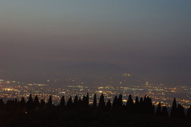 view over the city of Rome City Cityscape Cloud - Sky Copy Space Crowded Distance Golden Hour Haze Illuminated Mountain Mountain Range No People Non-urban Scene Outdoors Panorama Rome Scenics Sea Sky Sunset Tivoli Tranquil Scene Tranquility Trees And Sky Wide Shot