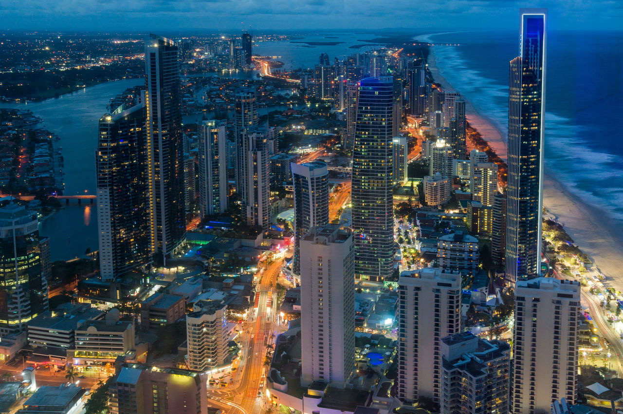 City skyscrapers at night, aerial, long exposure.Futuristic cityscape, Surfers Paradise, Gold Coast, Queensland, Australia Aerial View Australia Cityscape Coastline Evening Famous Place Gold Coast Infrastructure Modern Modern Architecture Night Skyline Skyscraper Surfers Paradise Tourist Attraction  Traffic Lights Travel Destinations Urban Urban Skyline View From Above