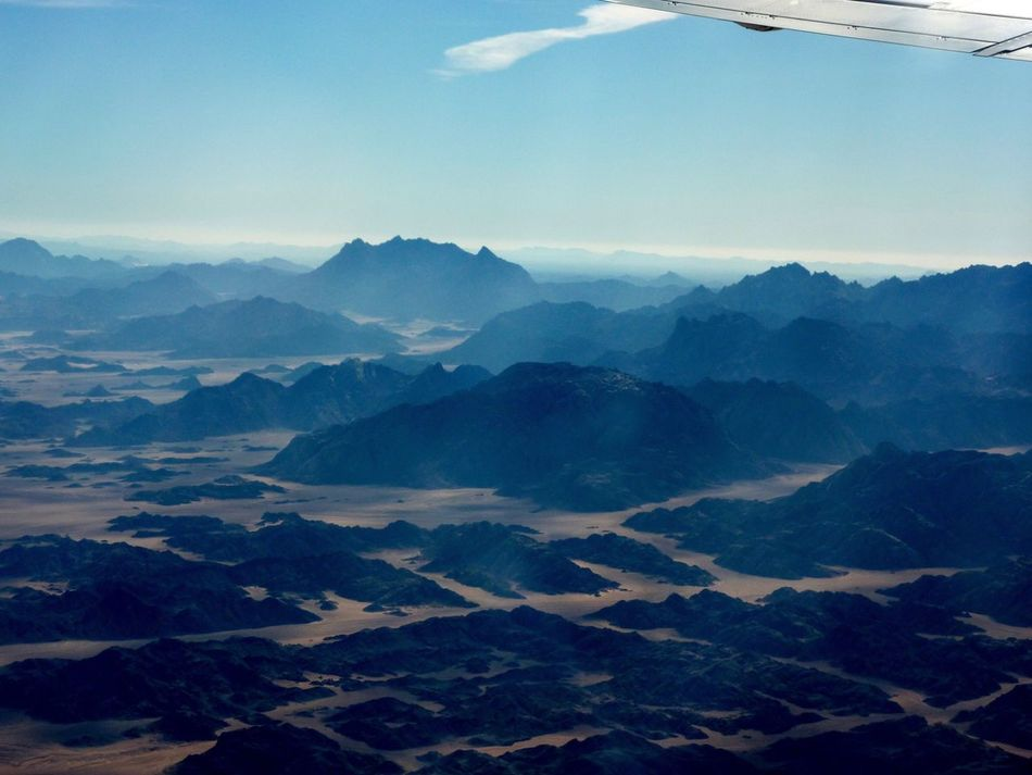 Flying High Mountain Scenics Beauty In Nature Nature Tranquility Sky Tranquil Scene Landscape Mountain Range No People Physical Geography Outdoors Cloud - Sky Day Cold Temperature EyeEmNewHere Flighing High Geometric Shape Aerial Photography Aerial View Egypt