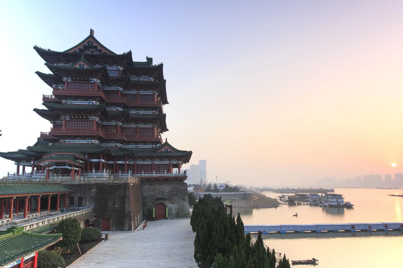 Nanchang, China - December 30, 2015: Tengwang Pavilion in Nanchang at sunset, one of the four famous towers in south China Architecture ASIA Built Structure China Chinese New Year Jianxi Metropolis Modern Building Nanchang Nature No People Orange Color Outdoors Pagoda Pavilion On Lake Province Scenics Sky Sunset Tengwang Tourism Tranquil Scene Tranquility Travel Destinations Water