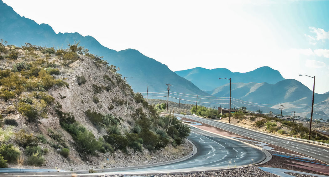 Beauty In Nature Clear Sky Curve Day Landscape Mountain Mountain Range Mountain Road Nature No People Outdoors Road Scenics Sky The Way Forward Tranquil Scene Tranquility Transportation Tree Winding Road The Great Outdoors - 2017 EyeEm Awards Breathing Space