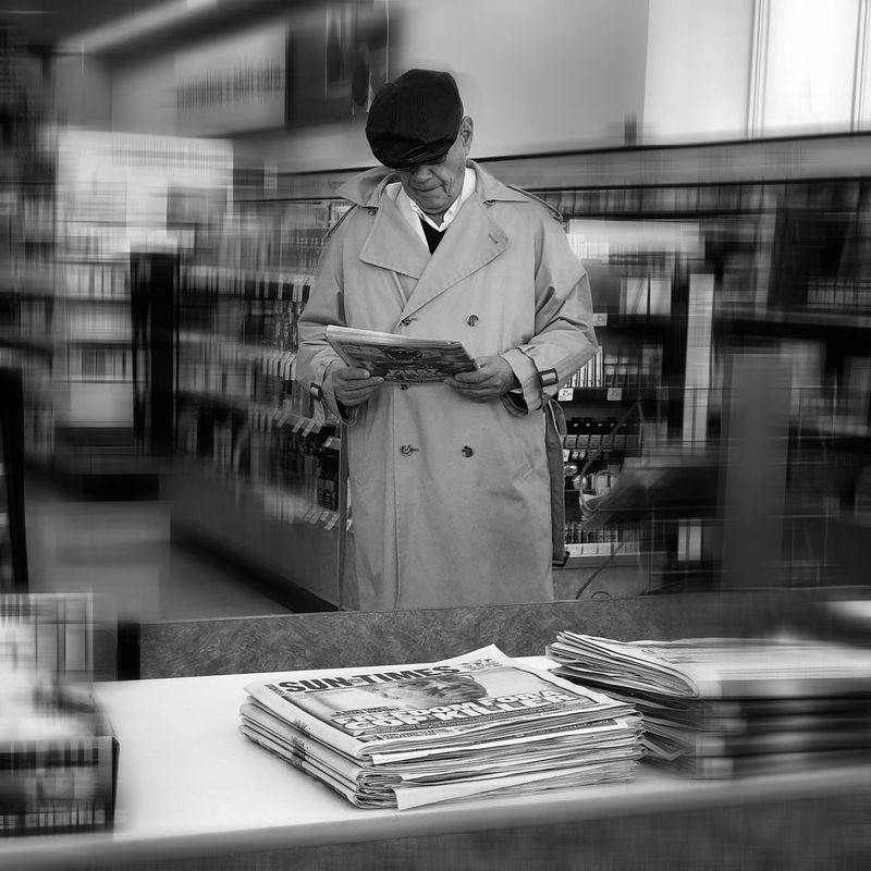 Black And White Standing One Person Men Occupation Looking Down Welcome To Black Indoors  Only Men Adult Adults Only Working Archival People Business Finance And Industry Raincoat Day News Paper Reading The News Reading The Newspaper Mature Man Nostalgia Nostslgic Old Way Of Life Man From The Past The Portraitist - 2017 EyeEm Awards