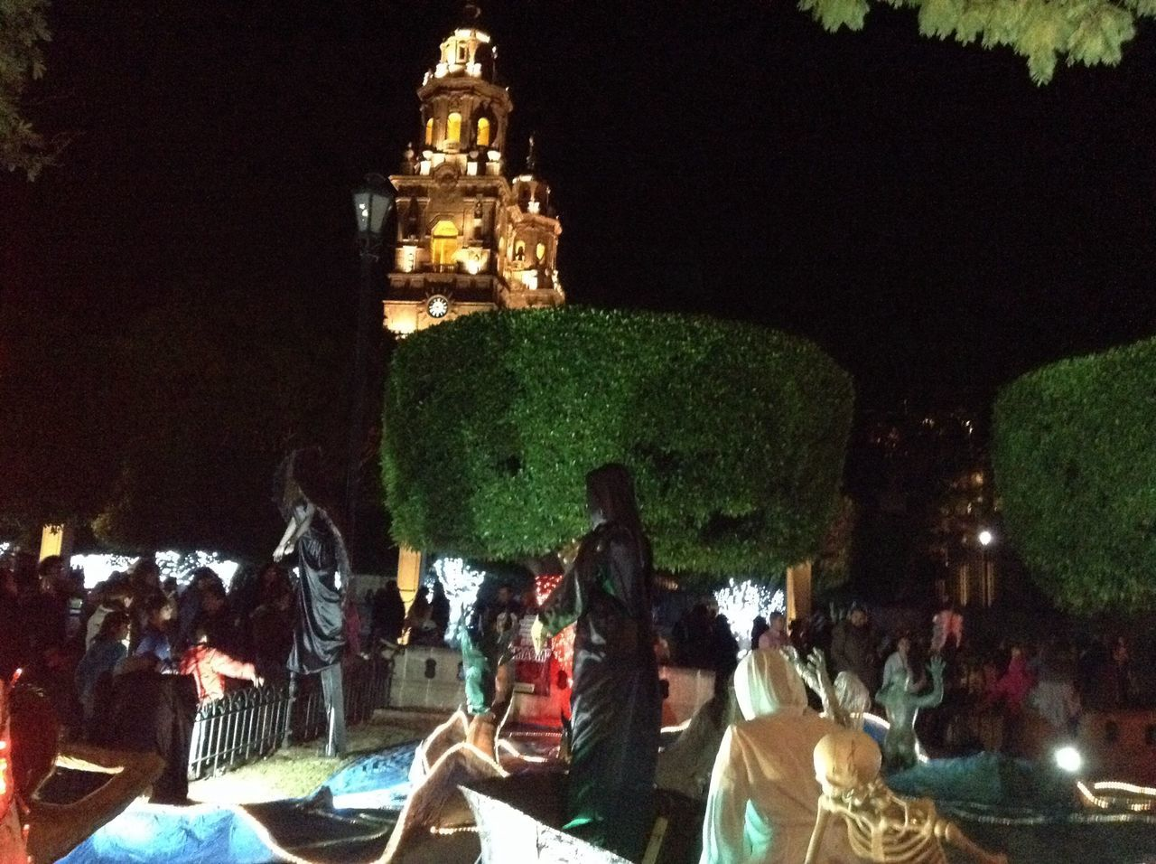 large group of people, real people, night, statue, men, women, sculpture, illuminated, spirituality, lifestyles, outdoors, architecture, built structure, tree, water, crowd, sky, people