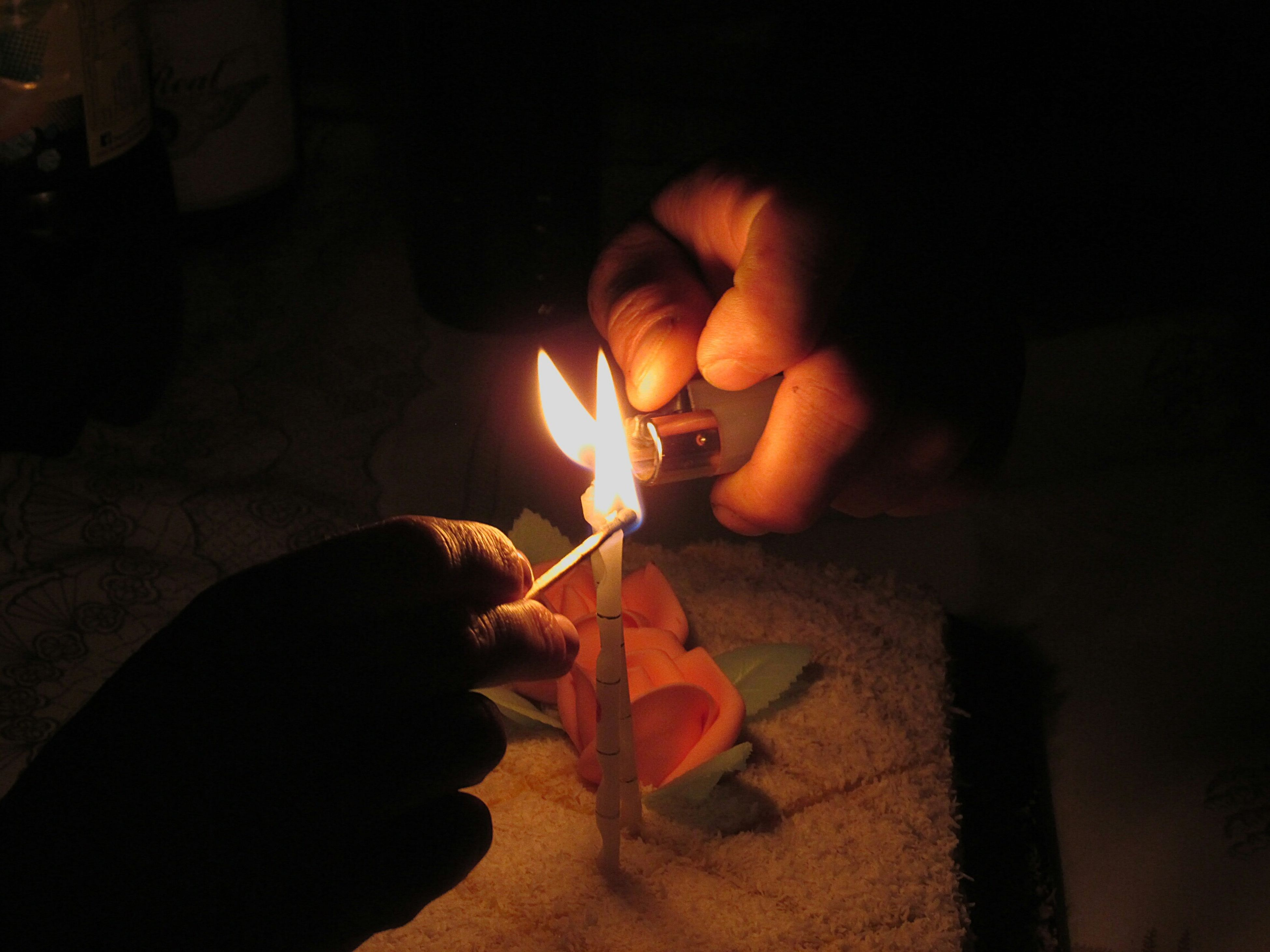person, holding, lifestyles, men, leisure activity, burning, flame, unrecognizable person, illuminated, night, part of, fire - natural phenomenon, human finger, cropped, indoors, glowing