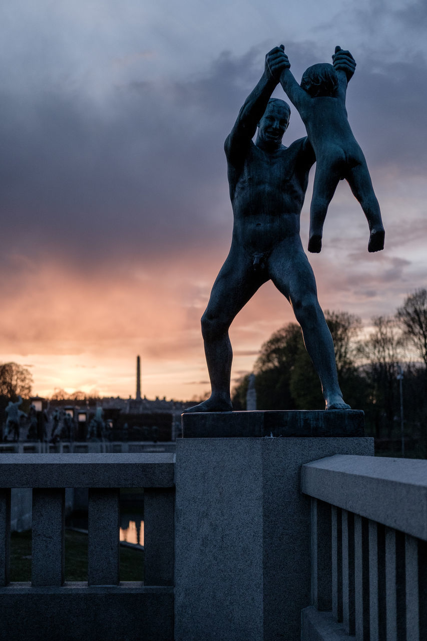 sculpture, statue, art and craft, creativity, sky, human representation, built structure, outdoors, no people, cloud - sky, architecture, sunset, day, city