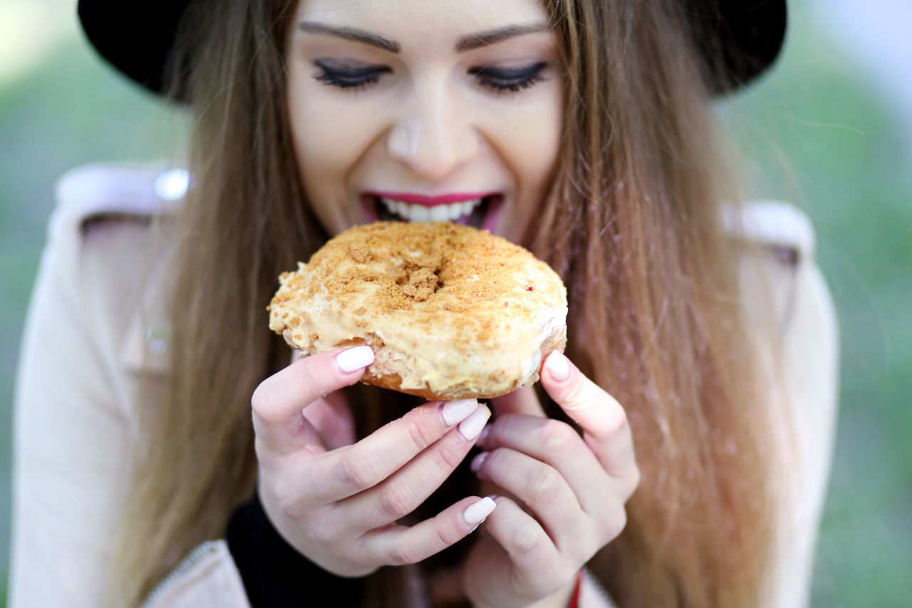 Close-up Donut Food Food And Drink Front View Human Hand Ready-to-eat Real People Smiling Sweet Young Adult Young Women
