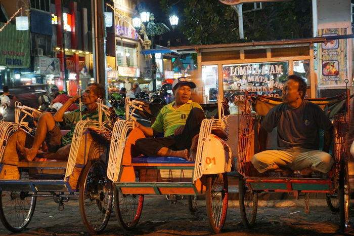 Becak driver chilling on their becak while waiting for customers. Becak INDONESIA Malioboro Street Nightlife Occupation Real People Transportation Traveling