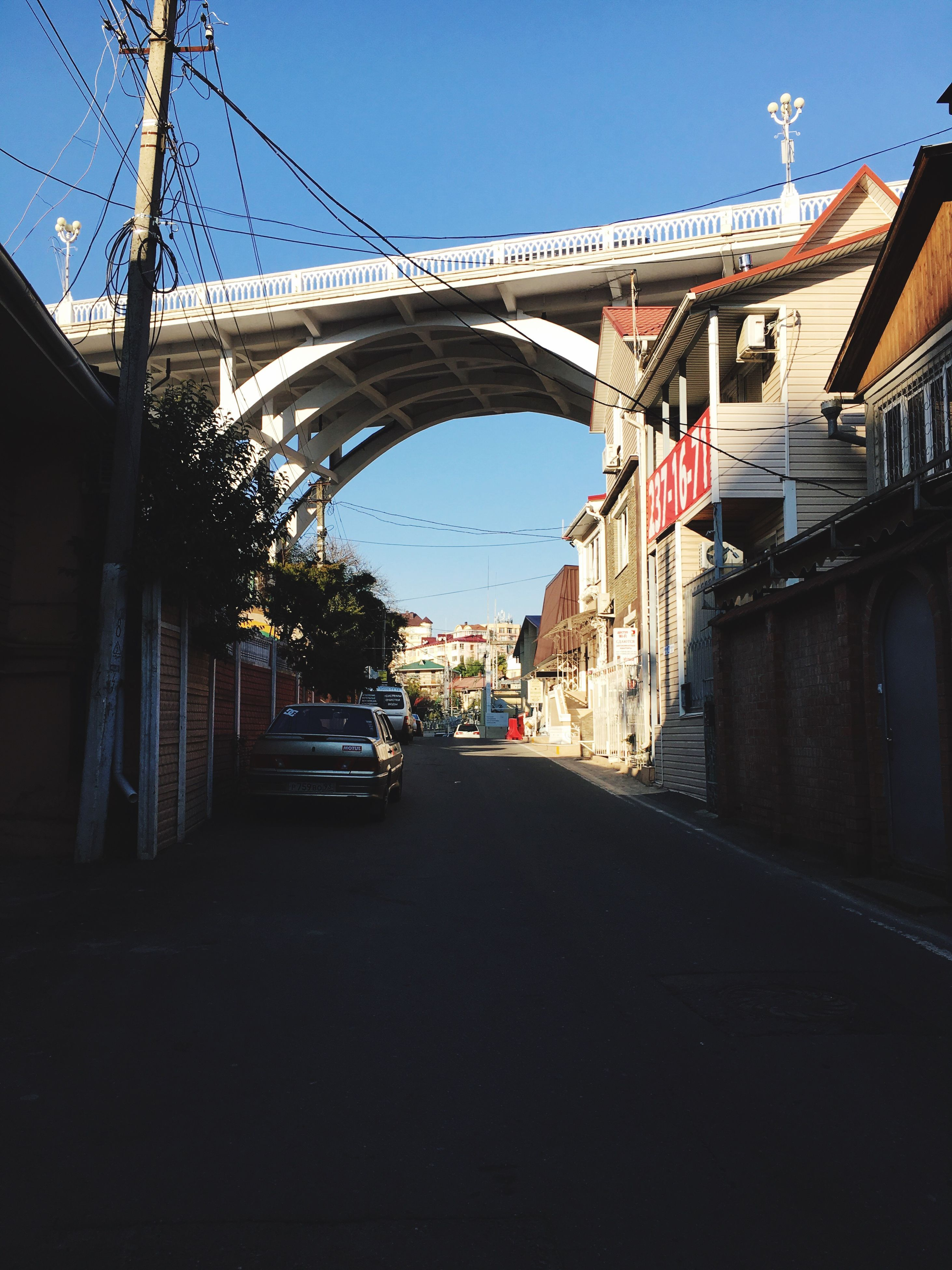 built structure, architecture, transportation, bridge - man made structure, sunlight, building exterior, outdoors, no people, day, connection, sky