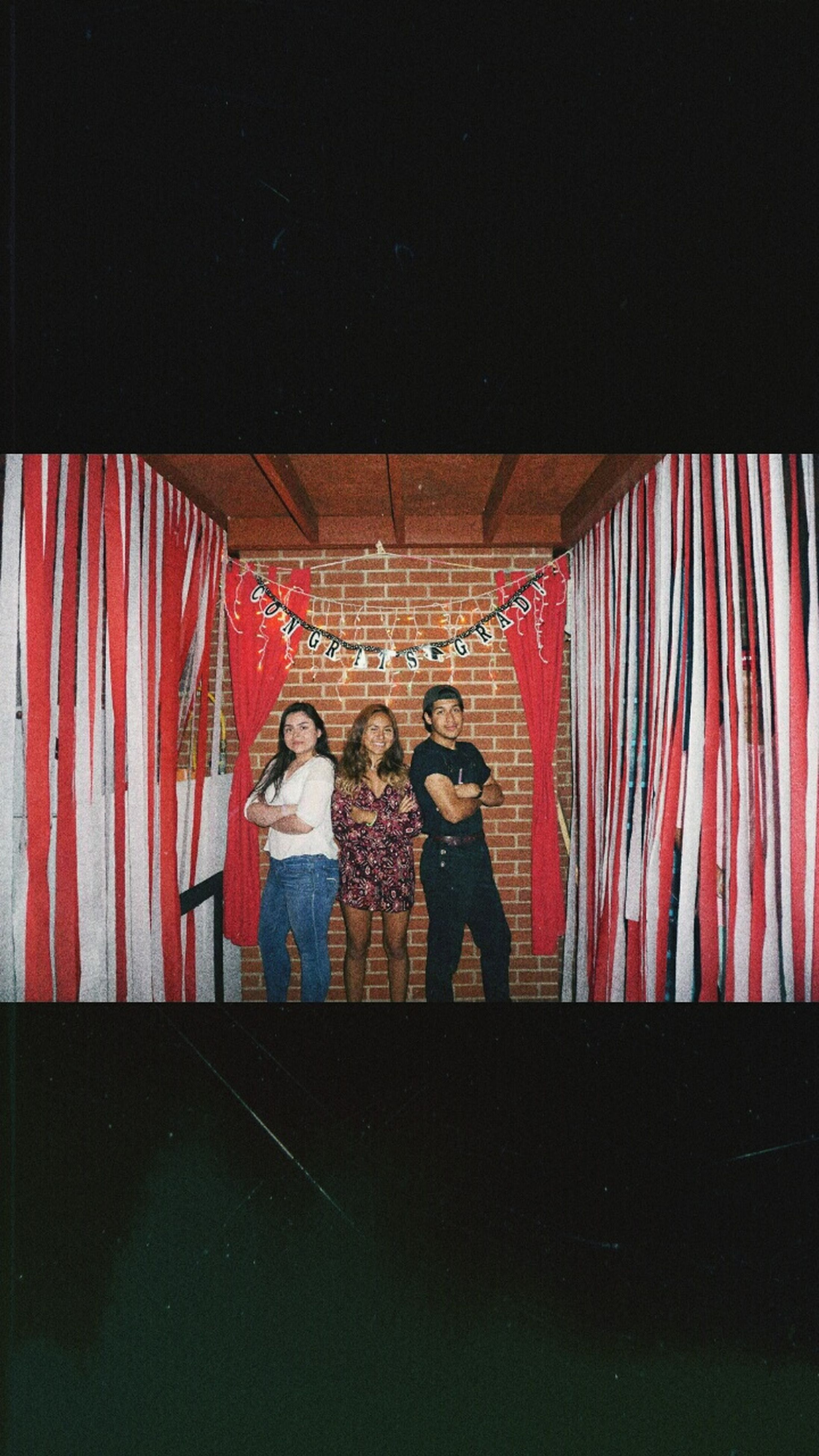 full length, real people, young women, leisure activity, standing, curtain, togetherness, celebration, young adult, indoors, lifestyles, women, night, bonding, friendship, two people, hanging, illuminated, men, adult, people