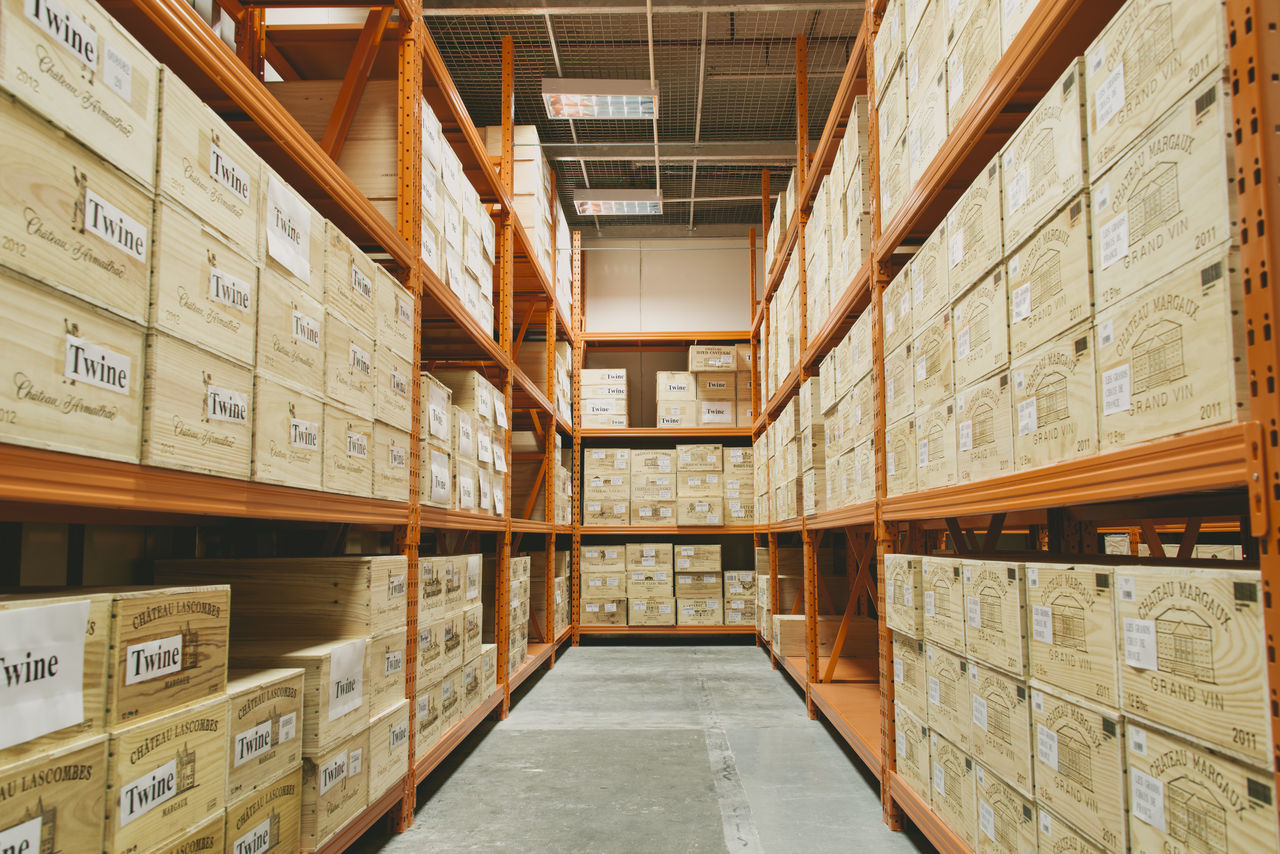 Box - Container Business Cardboard Cardboard Box Crate Day Delivering Distribution Warehouse Indoors  Industry Large Group Of Objects No People Pallet Retail  Shelf Shipping  Stack Storage Compartment Storage Room Warehouse