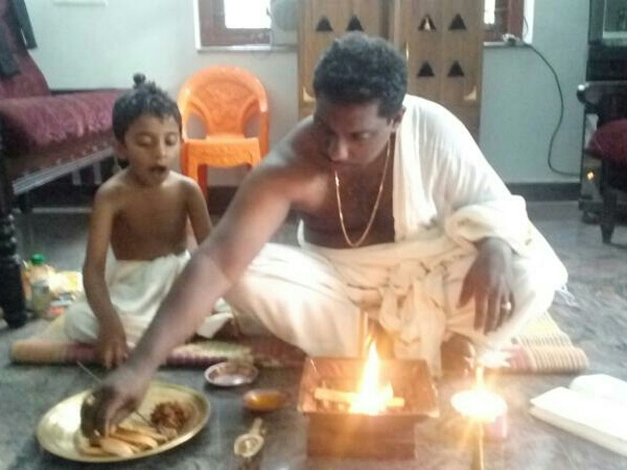 two people, togetherness, adult, adults only, people, sitting, domestic life, young adult, flame, playing, wellbeing, indoors, full length, day, food, only men, friendship