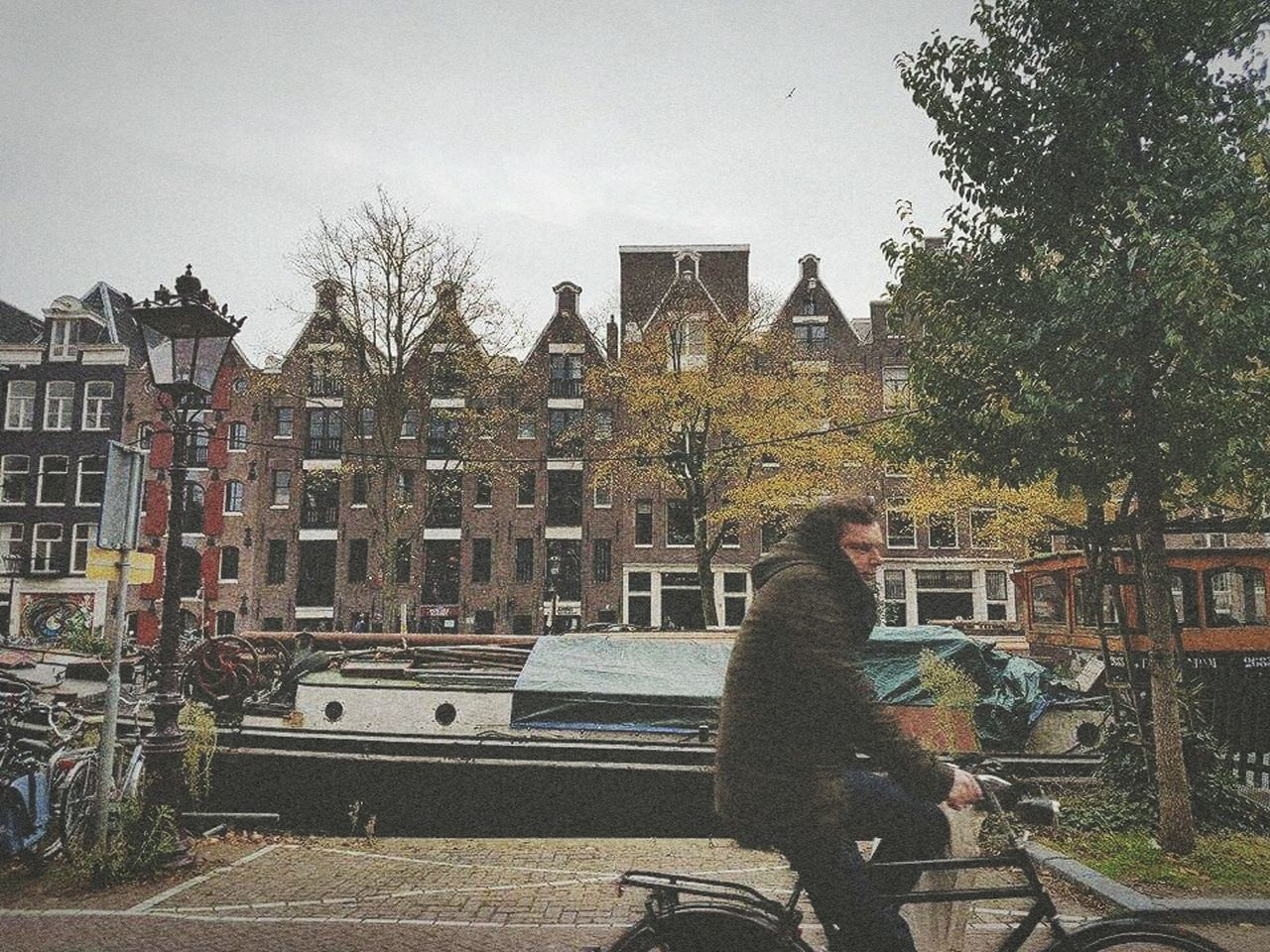 Amsterdam on film. Built Structure Building Exterior Architecture Travel Destinations Full Length Rear View City City Break Adults Only One Person People Outdoors Tree Only Men One Man Only Day Adult Amsterdam Traveling Bikesaroundtheworld Bikes
