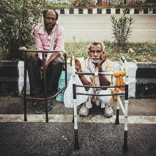 AIIMS Metro 26 Raghu Das (L) from Bihar and Gautam Lal from Madhya Prakash sit by a divider on the road near the AIIMS metro station. Both have been suffering from leg problems and have been undergoing treatment at AIIMS and have sought shelter at the metro station. Also, they have become friends and often spend time together. AIIMS metro station, New Delhi, serves as a temporary shelter for the family members of the countless patients undergoing treatment at the All India Institute of Medical Sciences (AIIMS). These people cannot afford to stay at lodges or hotels till their loved ones are treated, thus choosing to dwell at or in the vicinity of the AIIMS metro station. Also, the national capital has thousands who are homeless. Metro stations are one of the commonest spots where the deprived take refuge. Blankets, utensils, kitchen accessories, old cartons, tarpaulin sheets and other household paraphernalia are a common sight at these makeshift shelters. Communityfirst Yourshot Everydayeverywhere Everydayindia Dailylife Photojournalism Journalism Reportagespotlight Indiaphotoproject Outofthephone Onepluslife Myfeatureshoot Instagram Delhi Newdelhi India ASIA